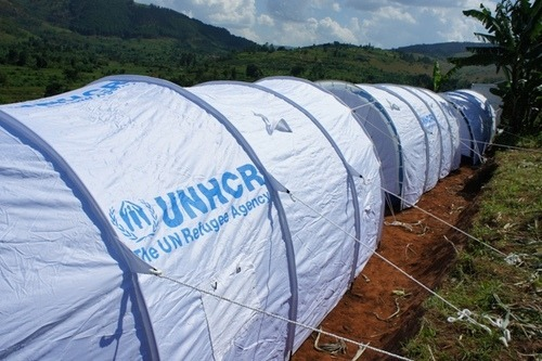 Shows the reader branding on humanitarian tarps.